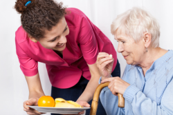 caregiver serving food