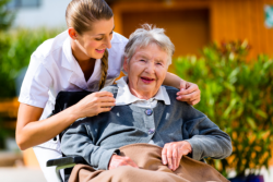 old woman in her wheelchair with her caregiver